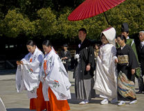Japanese shinto wedding ceremony. Maidens, new couple and their families wear traditional dress on the wedding ceremony at Meiji Jingu Shrine Royalty Free Stock Photography
