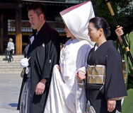 Japanese shinto wedding ceremony. New couple and their families wear traditional dress on the wedding ceremony at Meiji Jingu Shrine Royalty Free Stock Photography