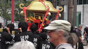 Japanese Shrine being carried during temple procession stock footage