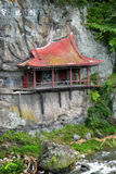 Japanese shrine built on rock face Royalty Free Stock Photos