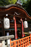 Japanese Shrine. With lanterns, traditional roof, bells, and stone work Stock Photos