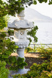 Japanese shrine in park near lake Stock Photos