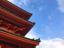 Side view of Japanese shrine roof against blue sky. Japanese shrine roof against blue sky, side view stock photos