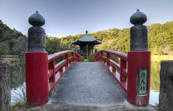 Japanese shrine. Small shinto shrine and bridge in autumn forest, Japan Royalty Free Stock Image