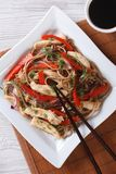 Japanese soba with chicken and vegetables top view vertical Stock Photo
