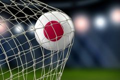 Japanese soccerball in net. Image of Japanese soccerball in net Royalty Free Stock Photos