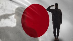 Japanese soldier silhouette saluting against national flag, brave sergeant. Stock footage stock video footage