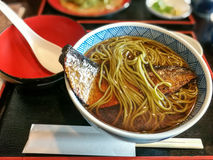 Japanese soup with soba noodle and fish Stock Image