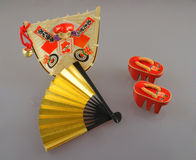 Japanese Souvenirs. Assorted Japanese souvenirs isolated on a solid background royalty free stock image