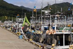 Japanese squid fishing boats. Docked at the harbour waiting for sunset to go out again Royalty Free Stock Images
