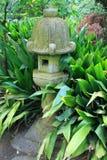 Japanese Statue in a Garden Royalty Free Stock Photos