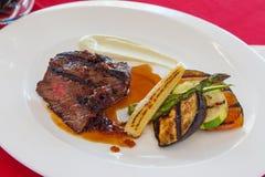 Japanese steak. Sliced japanese steak with roast vegetables royalty free stock photo