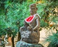 Japanese stone Bodhisatve statue Stock Photo
