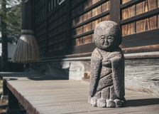 Japanese stone doll Garden decoration traditional style. Japanese stone doll Garden decoration Monk doll traditional style statue royalty free stock photos