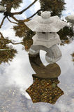 Japanese stone lamp with reflection. Stock Photos
