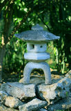 Japanese stone lantern. A japanese lantern in the backyard Royalty Free Stock Photo