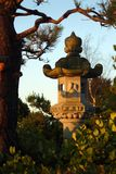 Japanese Stone Lantern. A Japanese stone lantern catching the rays of the morning sun in a Japanese garden Stock Photos