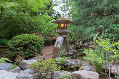 Japanese Stone Lantern by the Creek Royalty Free Stock Photo