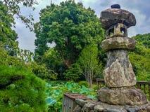 A Japanese Stone Lantern, focus lantern. Kioto, JAPAN - Aug. 02 2017: A Japanese Stone Lantern, focus lantern royalty free stock photography