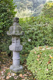 Japanese Stone Lantern in Garden Stock Photography