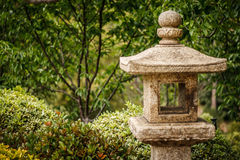 Japanese Stone Lantern in a Garden Setting Royalty Free Stock Images