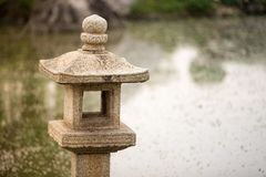 Japanese stone lantern. In public park Royalty Free Stock Images