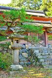 Japanese stone lantern and temple gates. Stock Photo