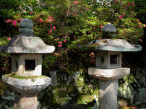 Japanese stone lanterns. Two Japanese stone lanterns in a specific garden Royalty Free Stock Image