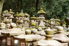 Japanese Stone Lanterns. Group of Japanese Stone Lantern in an ornamental garden at Kyoto, Japan Stock Photo