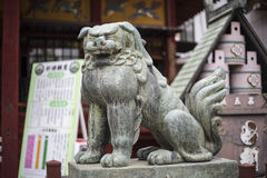 Japanese stone lion Stock Photos