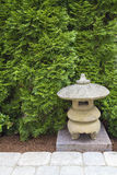 Japanese Stone Pagoda. In Backyard Garden Paver Patio Royalty Free Stock Photography