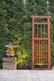 Japanese Stone Pagoda Lantern and Trellis. In Backyard Paver Patio Stock Photos