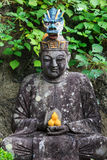 Japanese stone statue Royalty Free Stock Photo