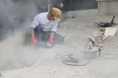 Japanese Stone Worker in Action Stock Photos
