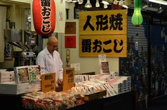 Japanese store owner mans Tokyo shop after dark Stock Photography