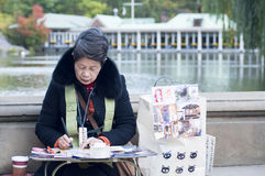 Japanese street artist painting in Central Park New York City Stock Image