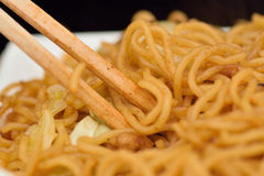 Japanese Street Food Fried Yakisoba Noodles with wooden Chopsticks Royalty Free Stock Image