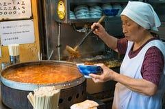Japanese street food vendor preparing food in Tokyo Stock Photography