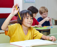 Japanese student raising hand Stock Images