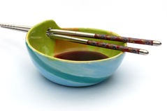 Japanese style bowl with soya sauce and chopsticks Stock Image