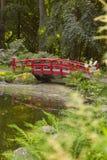 Japanese style bridge in garden Stock Image