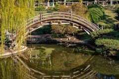 Japanese Bridge Span. A Japanese style bridge spans a pond at the Huntington Library in Pasadena, California stock photo