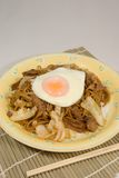 Japanese style fried noodles with fried egg Royalty Free Stock Photos