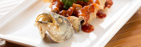 Japanese style fried sea bass, served with sweet and sour sauce Royalty Free Stock Photo