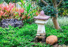 Japanese style garden with stone lantern. In the park Stock Photos