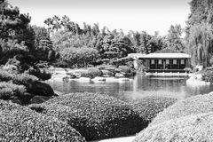 Japanese Style Garden with Teahouse Royalty Free Stock Photography