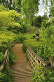 Japanese style garden. View of wooden bridge and path through Japanese style garden on island, Regent's Park, London Stock Photography