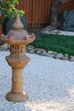 Japanese Style Lantern Garden Decoration Stone Candle Holder. A Japanese Style Lantern Garden Decoration Stone Candle Holder royalty free stock photos
