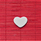 Japanese style love heart on red bamboo mat Royalty Free Stock Images