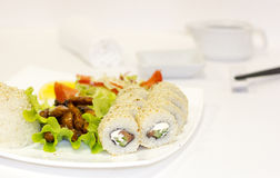 Japanese-style lunch with teriyaki chicken, rice, fresh vegetables and rolls Royalty Free Stock Image